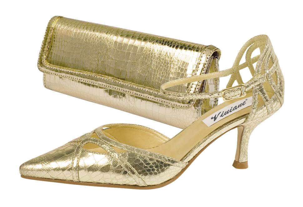 Fotografia złotego buta i torebki