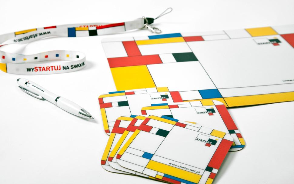 Seria gadżetów reklamowych - długopis, smycz, podkładki pod kubek i myszkę.